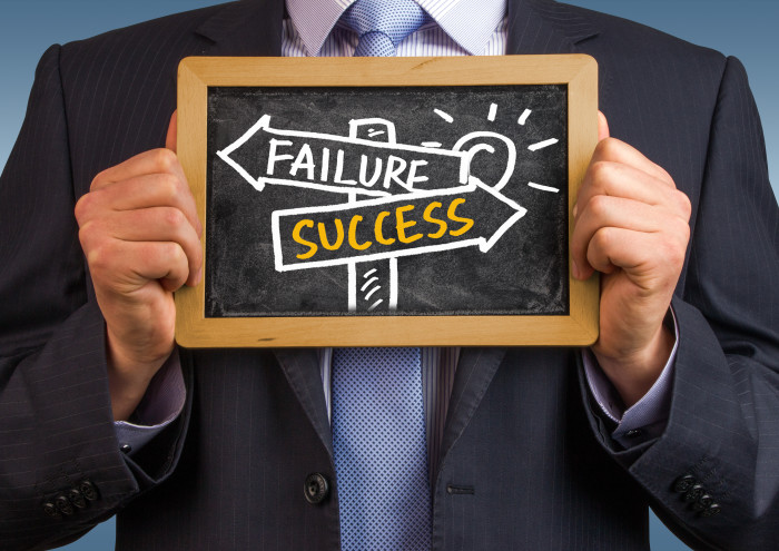 success or failure signpost concept hand drawing on blackboard